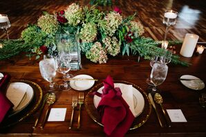 Table Setting with Red Linens and Gold Flatware