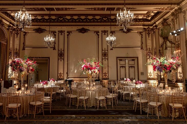Glamorous Gold Reception with Tall Pink Centerpieces and Chandeliers