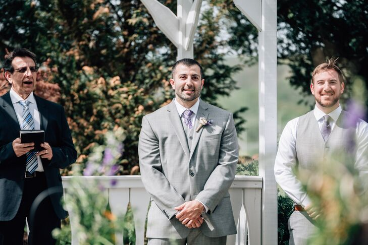 Brendan wore a gray three-piece suit with a lavender paisley tie on his wedding day.