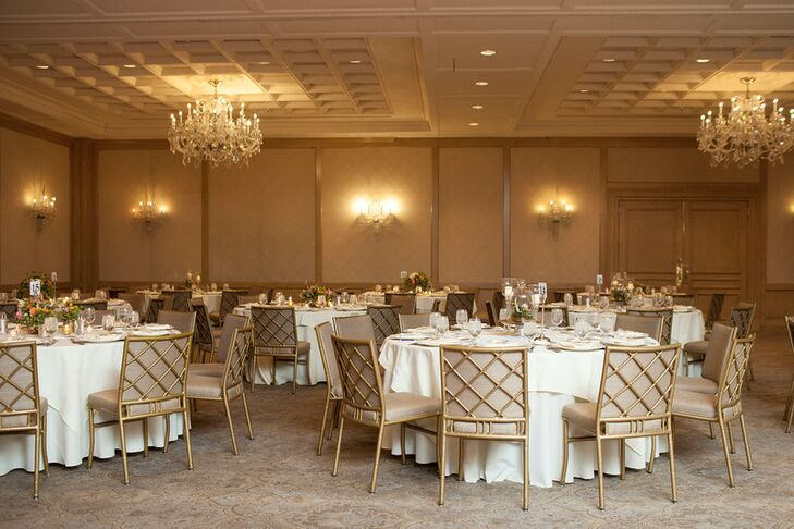 Warm golds and soft champagne hues paired with the antique-inspired decor of the hotel for an elegant reception look.