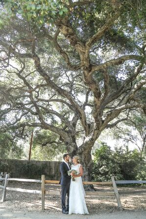 Couple Posed in Front of Large Tree
