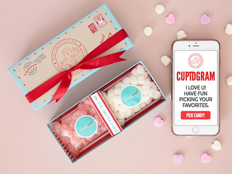 Candy-gram message on mobile phone and box of two types of candy