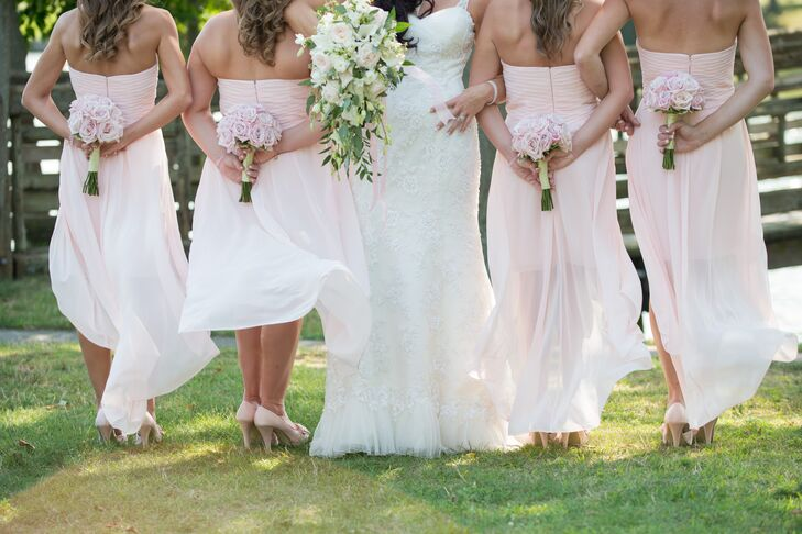 The bridesmaids wore matching strapless, chiffon dresses with sheer overlays in an asymmetric cut.
