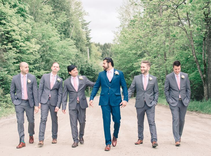 "While his groomsmen sported gray suits and pink ties, Indesh opted for a look all his own. He had a custom three-piece navy suit made by Indochino for the occasion, which he paired with sharp brown oxfords and a pale pink tie. ""He looked like a Bollywood movie star in it, and I couldn't get over how handsome he looked,"" Nancy says."