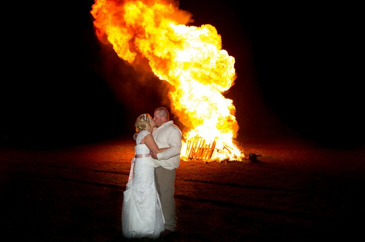 Bride and Groom Kissing In Front of a Bonfire