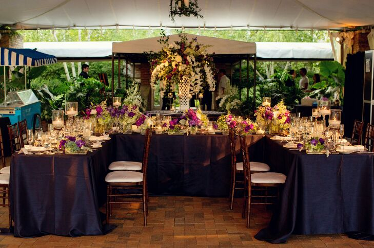 The couple wanted to keep things elegant, so a  mix of purple flowers and succulents in glass vases sat on the tables.