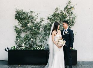For their romantic rooftop wedding, Olivia	Tran and Phu Le drew inspiration from Japanese cherry blossoms. The delicate pink flower showed up everywhe