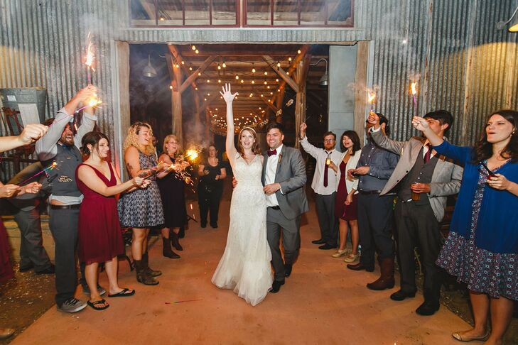 Using matchbooks that served as favors and escort cards, guests lit sparklers and waved Anika and Adam off into the night.