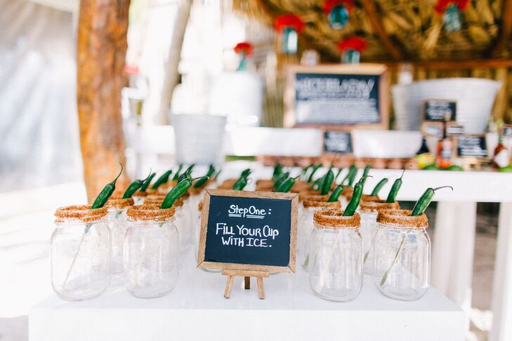 Danielle and Jason set up a Mexican-inspired cocktail bar, with mason jars lined with spices and a pepper. Guests could choose to fill the mason jar cocktail glasses with micheladas or strawberry margaritas.