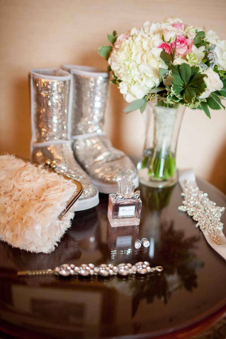 Emily accented her tulle mermaid-fit wedding gown with a dazzling bridal belt and a tan fur shawl to keep her warm during the photo shoot. She warmed her toes with a sparkly sequined pair of Ugg boots, which she wore before and after the ceremony.