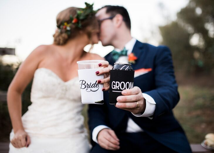 "Jogee and Joey celebrated with a kiss and cute ""bride"" and ""groom"" can koozies."