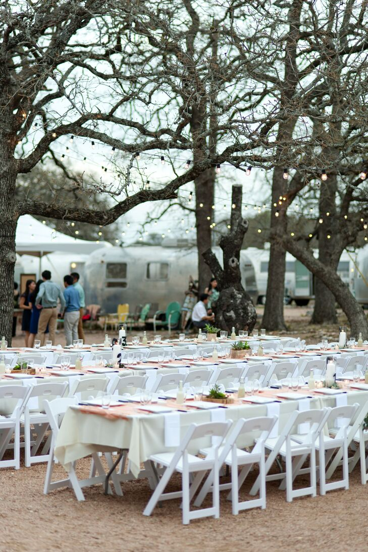 """The couple wanted an outdoor party where people didn't have to worry about the formalities of a wedding.  """"We just wanted our families and close friends to come, celebrate, eat well and have some fun,"""" says Minh. The couple chose to have their ceremony in an intimate space Three Points Ranch calls Eleven Oaks, embraced under a grove of oak trees. Dark wooden benches framed the ceremonial altar."""