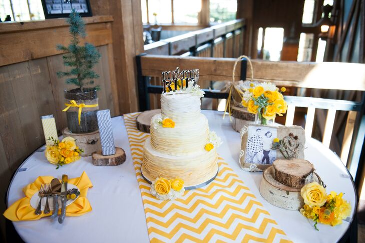 Jessica and Phil enjoyed a three-tier ruffled white buttercream cake decorated with yellow ranunculus and topped with a silver topper.