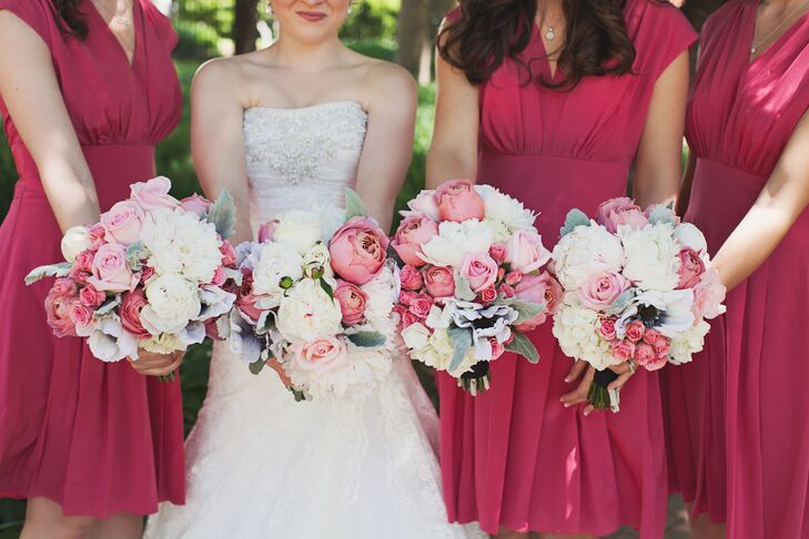 The bridesmaid bouquets echoed Emily's arrangement for a cohesive look. The flowers included anemones, peonies, hydrangeas, roses and lamb's ear. The bridesmaids wore pink knee-length dresses from Anthropologie, and Emily loved how the pink and white bouquets popped against their attire.