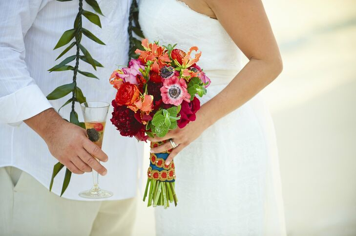 Rhiannon carried a bright, tropical bouquet of roses, peonies, lilies, cosmos and spearmint leaves.