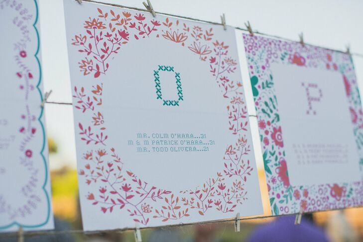 When it was time to head to the reception, guests consulted the cross-stitch inspired seating charts. The charts were in alphabetical order, listing the guests by last name and table number and had bright, floral borders.
