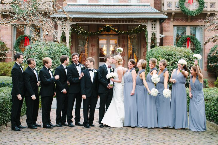 The bridesmaids wore gray Bari Jay dresses with flowery detailing on the shoulders. Chris wore a custom tuxedo, cummerbund and bow tie from High Cotton and the groomsmen wore tuxedos from Jos. A. Bank.
