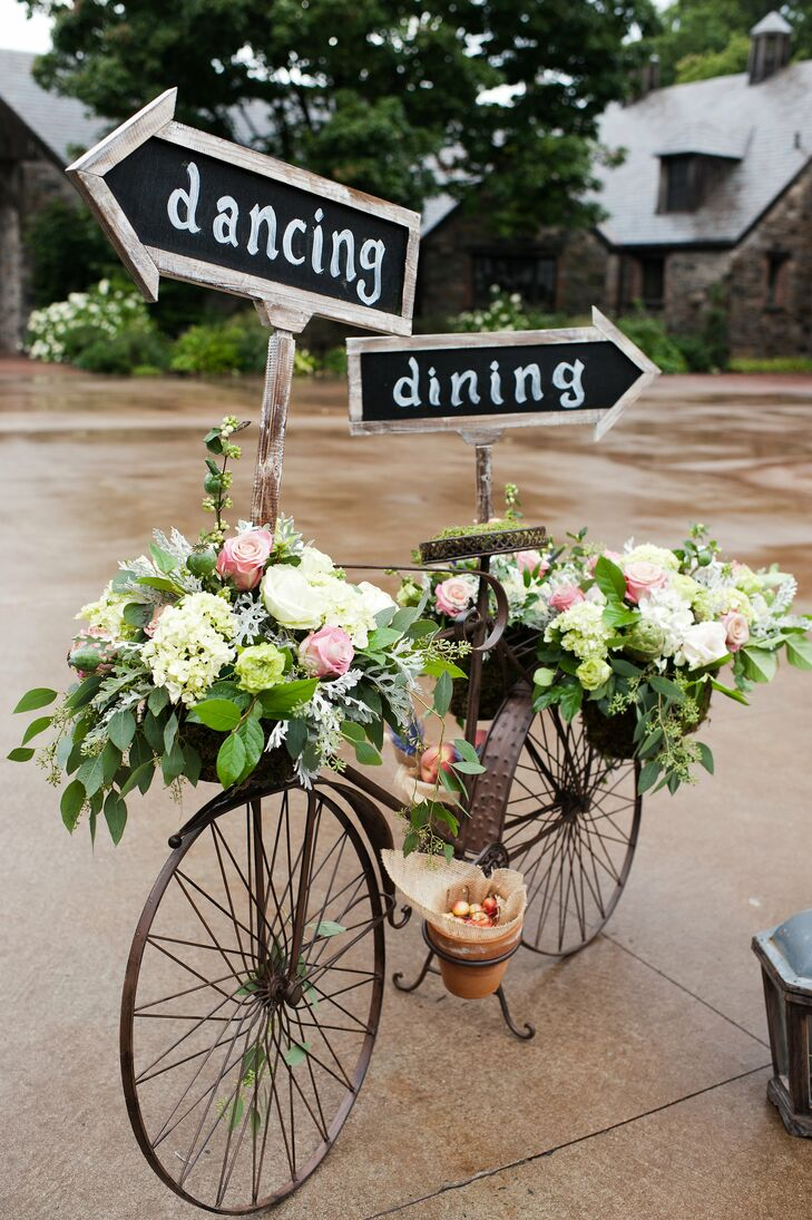 As an adorable décor addition, a metal bicycle decked out with flowers and chalkboard signs directed guests to the dinner and dancing.