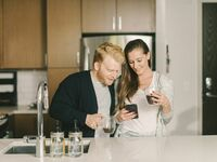 Couple registering from gifts on phone at home