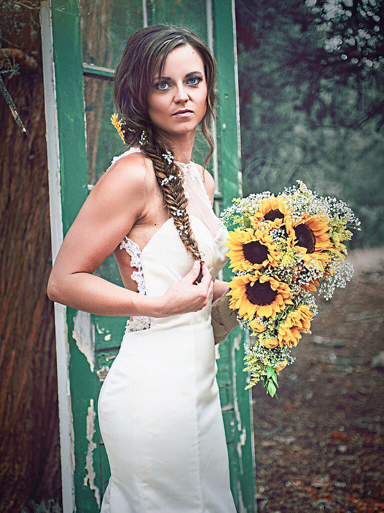 Sideswept fishtail wedding hairstyle for long hair and bangs