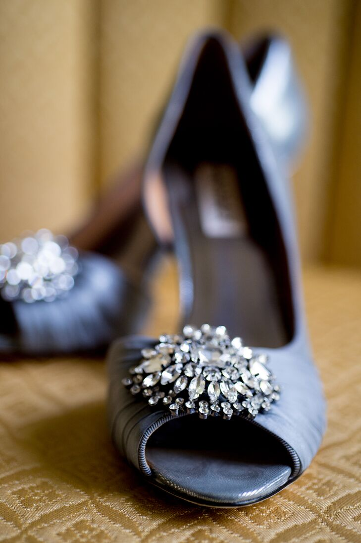 Lisa chose silver gray heels by Badgley Mischka Pearson for their comfort and crystal detail, which complimented her marquee crystal earrings by BHLDN and crystal clustered belt.
