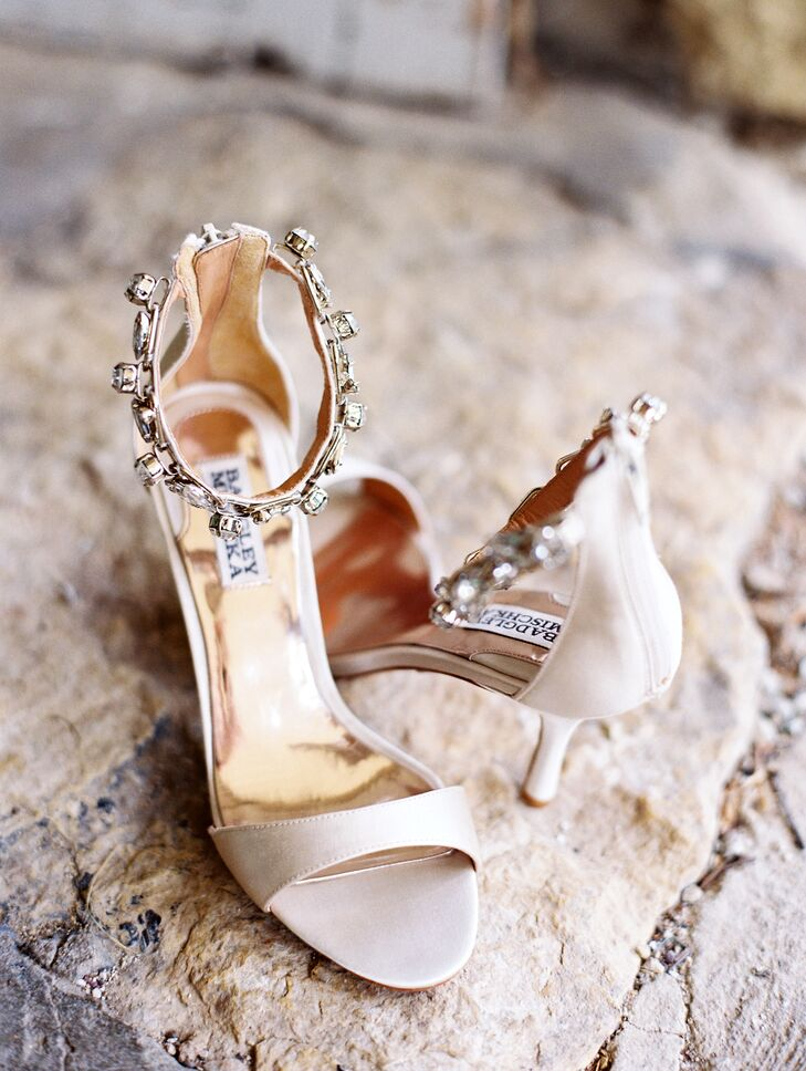 To give her look a subtle hint of glam, Kristina wore a pair of champagne Badgley Mischka sandals with crystal-embellished ankle straps for her walk down the aisle.