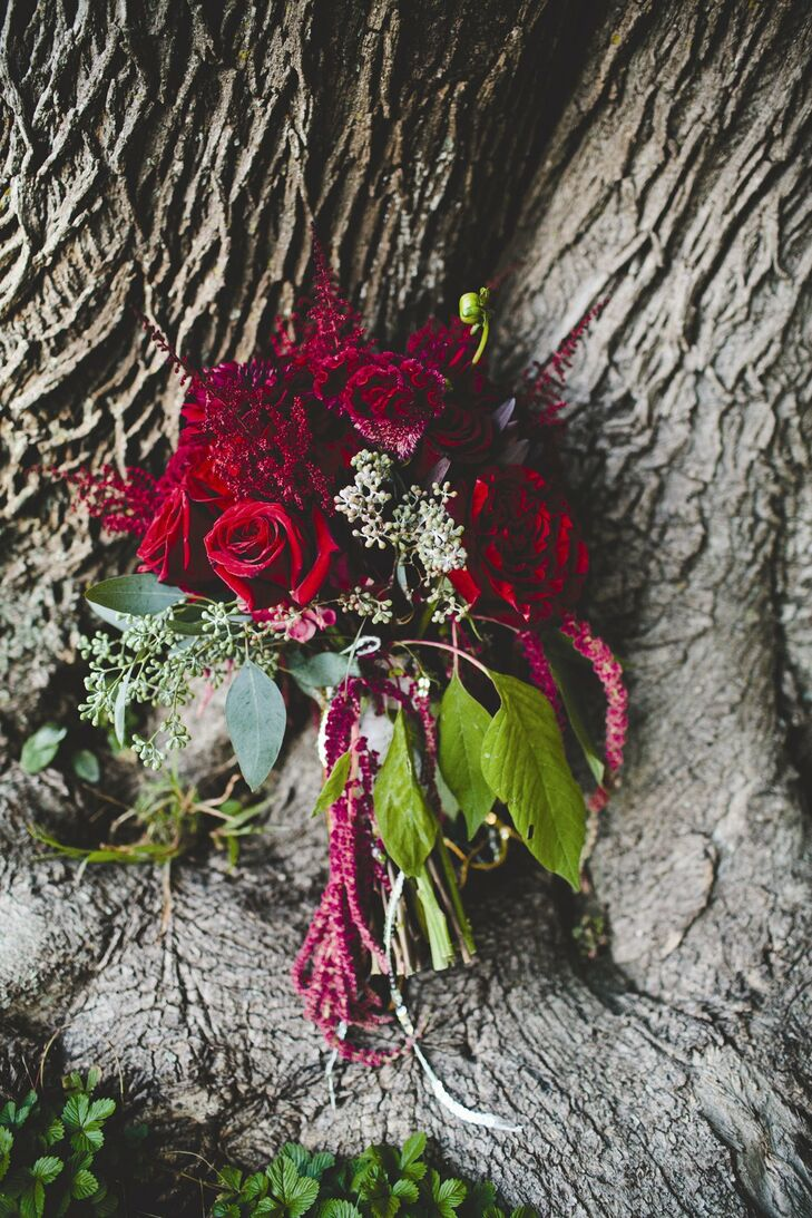 Julie wanted her bouquet to be a huge spray of rich red flowers dripping with amaranthus and her florist certainly delivered! The result was a bold combination of garden roses, dahlias, hydrangeas, astilbe and celosia, with plenty of amaranthus adding texture.