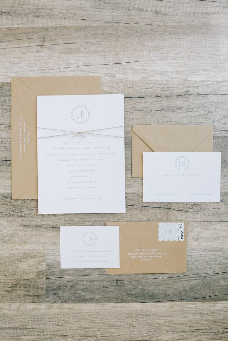 """Our custom-made letterpress invitations from Sugar Paper were simple and contemporary, with clean fonts in pale blue on crisp white stationery,"" Leah says. ""We designed our own monogram which was included on the invitations, the programs, and was painted on our distressed wood aisle treatment. We finished off the invitations with a small piece of twine to tie in the sand element of our wedding day."""