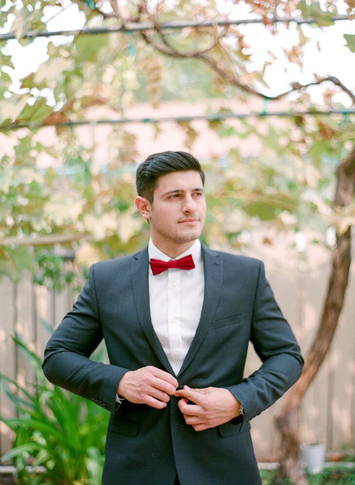 Formal but not fussy, Vazgen and his groomsmen wore dark gray suits with deep crimson bow ties to match the bridesmaid dresses.