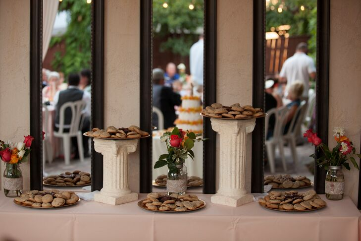 Katie baked homemade cookies and brownies the morning of the wedding. She positioned these sweets on the dessert table, some propped on top of white pillars at the reception at Randall House in Bakersfield, California.