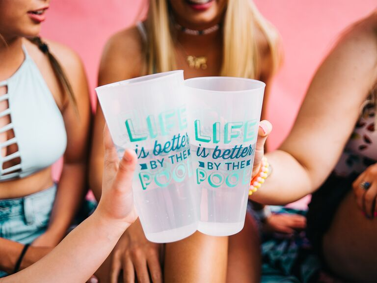 """""""Lfe is better by the pool"""" bachelorette cups"""