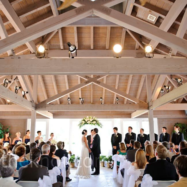 A close friend of the couple performed the ceremony beneath an arch adorned with hydrangeas, roses and greenery.