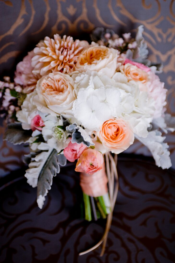 Blumgarten florist created this lush bouquet using a variety of garden roses, hydrangeas and mums in soft, muted colors. The couple's florist included succulents and silver sage for an added pop against the other blush-colored blooms.