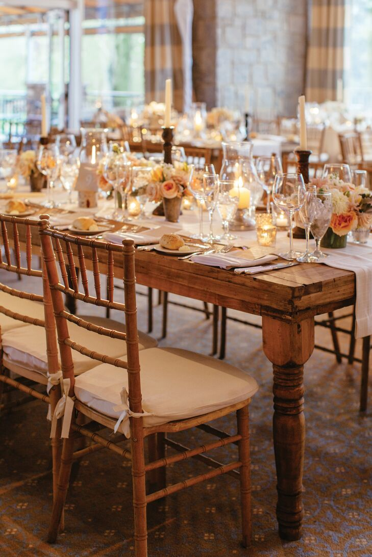 """""""I kept gravitating towards wooden farm tables and soft, neutral colors, so a distinct style took shape quickly,"""" says Jenna. After hours on Pinterest and some help from The Event Of A Lifetime, Inc, they took her ideas and formed that rustic, elegant vibe with blush runners and lush tablescapes. Birch posts also held up each table number."""