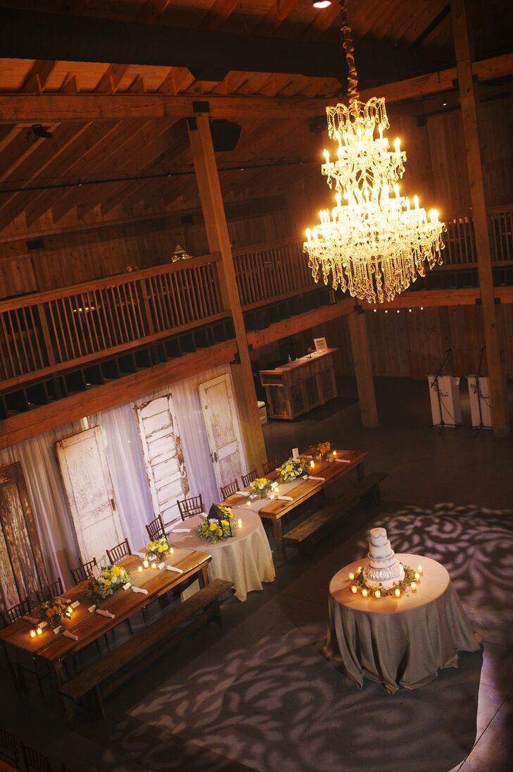 The wedding reception was held inside Mint Springs Farm in a large hall with wood details and beautiful chandeliers.