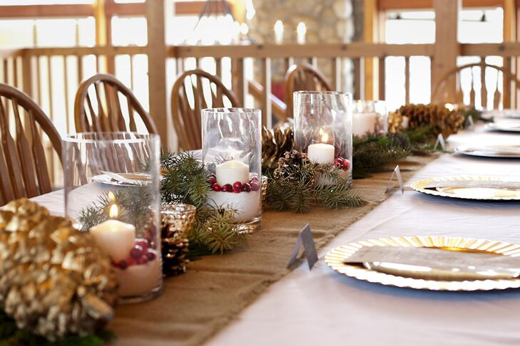 The reception tables were decorated with burlap table runners topped with white pillar candles in salt to look like snow and adorned with cranberries, pine and pinecones.