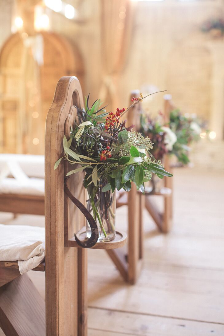 Mariellen and Blake looked to the season for inspiration when choosing their ceremony decor. The pair adorned the chapel's quaint wooden pews with small bundles of eucalyptus, olive leaves, berries and soft white blooms to bring an air freshness and life to the chapel's rustic, intimate interior.