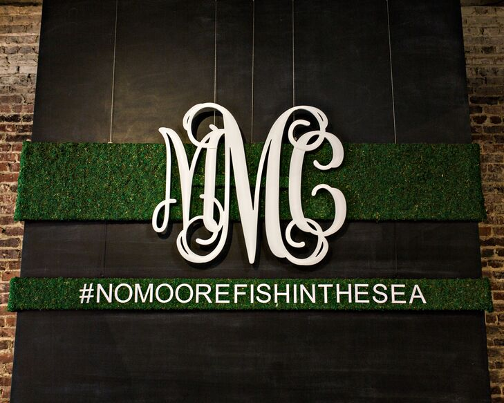 Moss backdrop with monogram and hashtag