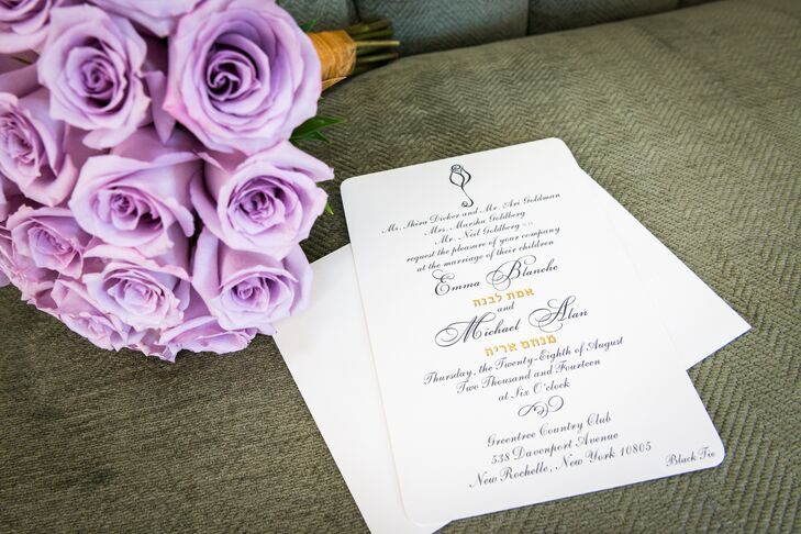 Emma and Michael fit out their traditional wedding with stationery that was nothing short of classic. They chose black-and-white invitations with their Hebrew names in a pretty gold font and a simple rose accent. The single rose was also used as a motif in their ceremony programs.