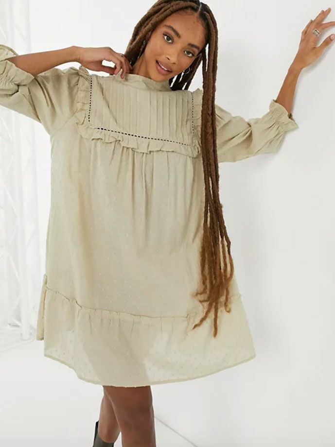 Muted green mini cottagecore dress with pleated ruffled neckline and long sleeves