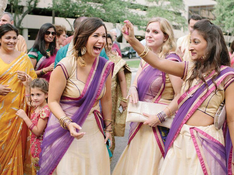 Smiling bridesmaids in colorful saris