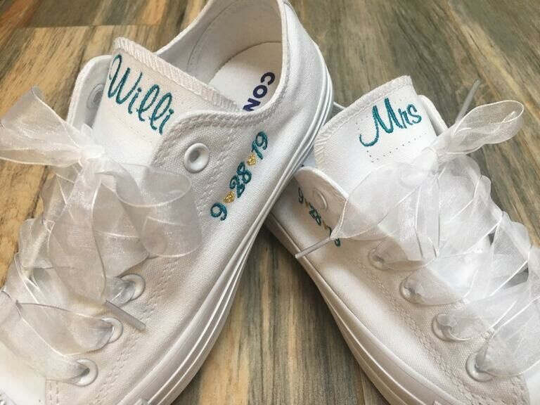 White Converse embroidered with newlywed's new title and wedding date