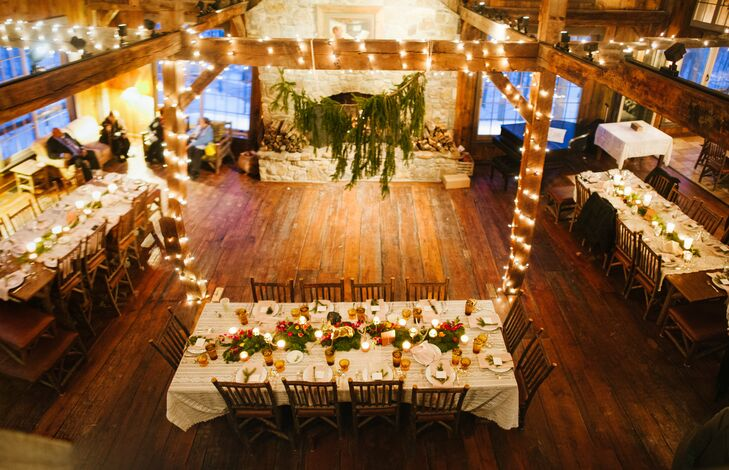 """Our reception had a very lodge-like feel with all-wood interior, high ceilings and a wood-burning stone fireplace, which we definitely took advantage of,"" Paula says. ""It truly was the perfect venue for a winter wedding."""