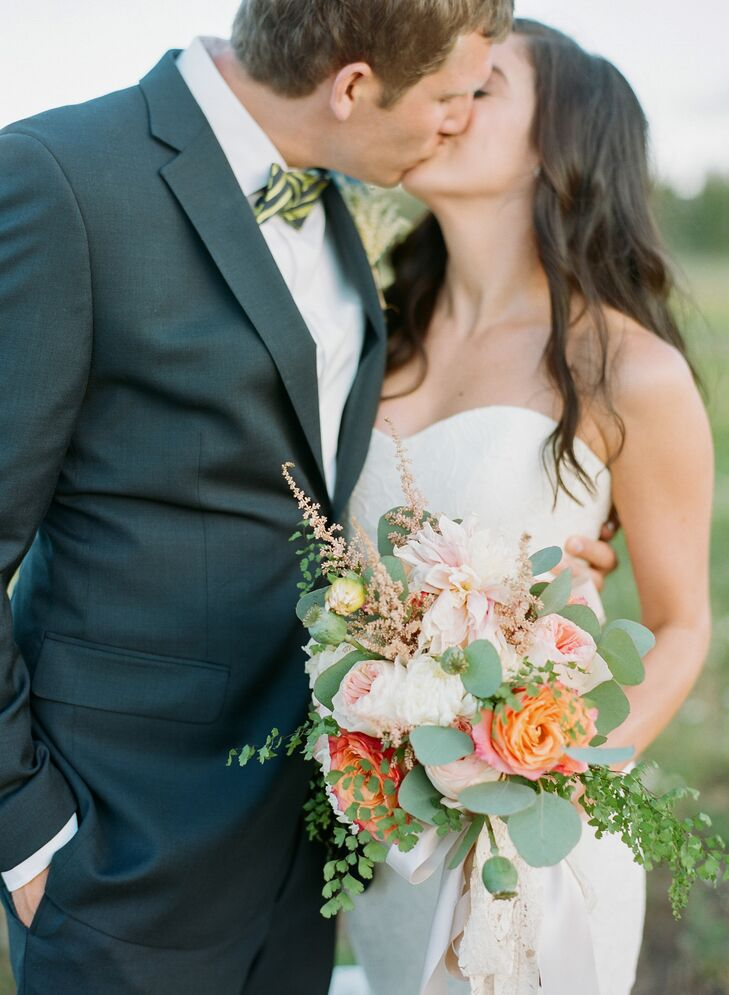 Nicole carried a coral and ivory bunch of garden roses, dahlias, astilbe, scabiosa, eucalyptus, mint, and maidenhair fern (Alex's favorite). The stems were wrapped in a lace ribbon from her grandmother's wedding dress, a sentimental touch.