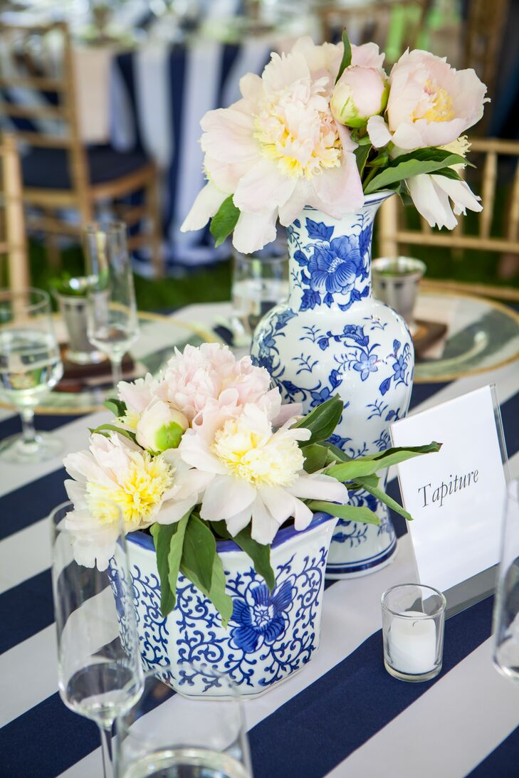 Kate and Julian share a love for the color blue and the bride searched thrift stores and antique shops for navy and white porcelain vases to use as centerpieces.