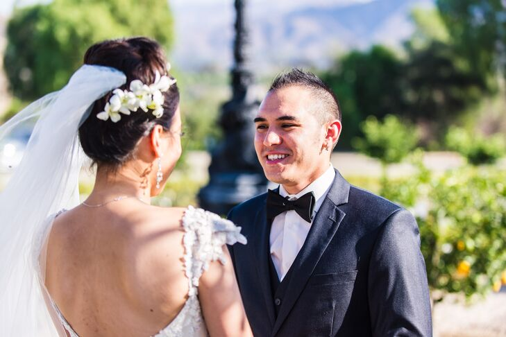 Groom Smiles at his Bride during the First Look