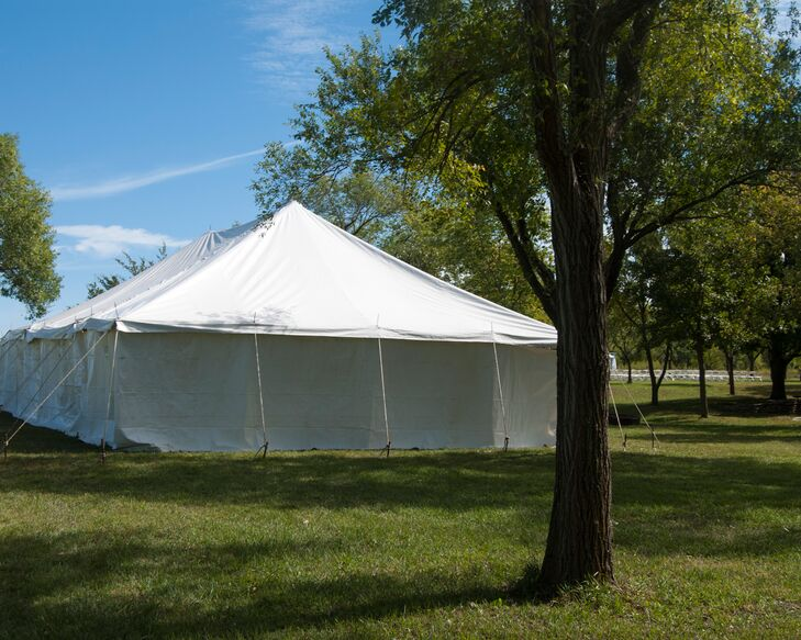 After the outdoor ceremony, the couple had a tented reception in the park.