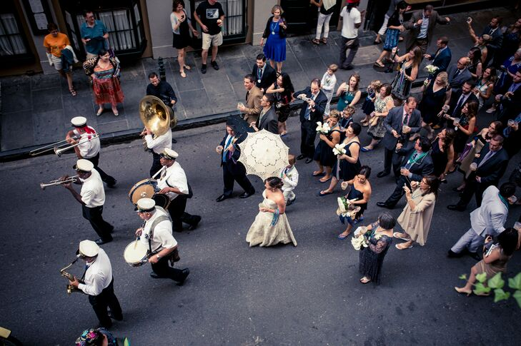 Since their wedding was in the French Quarter, Kendra and Adam didn't want to pass up an opportunity for a second line. They embraced the New Orleans tradition and took to the streets for an elaborate parade with their 180 guests and the Storyville Stompers brass band. They even carried traditional black-and-white lace parasols.