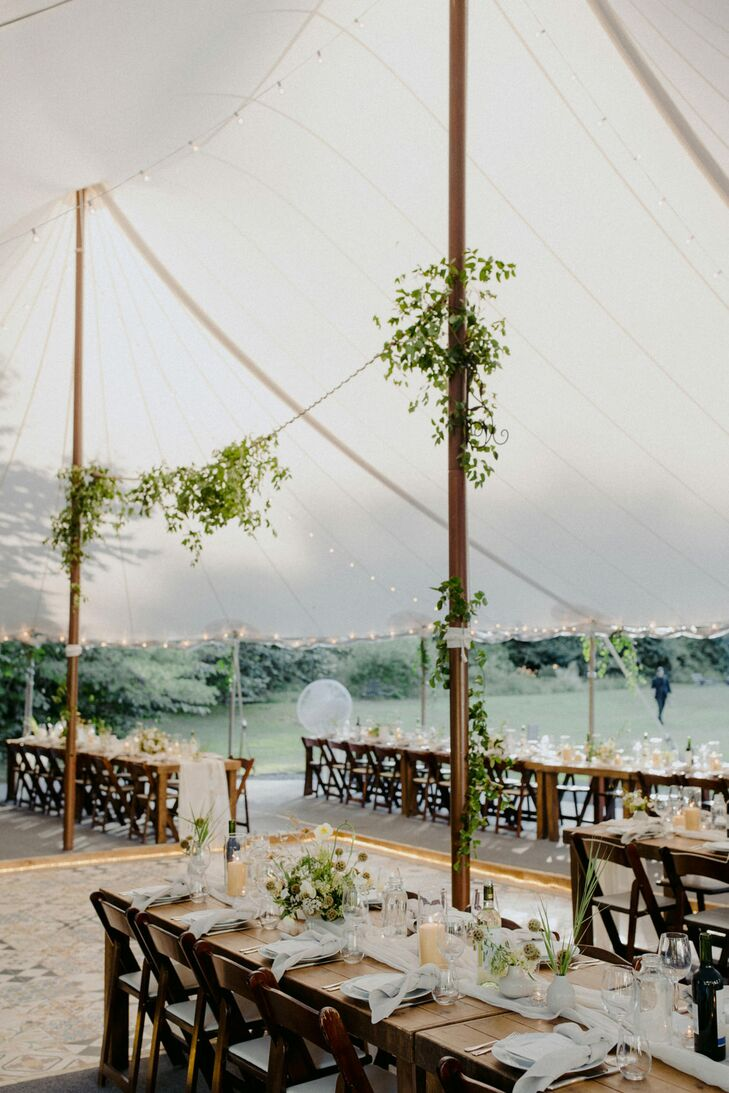 Tented Reception with Farm Tables and Greenery