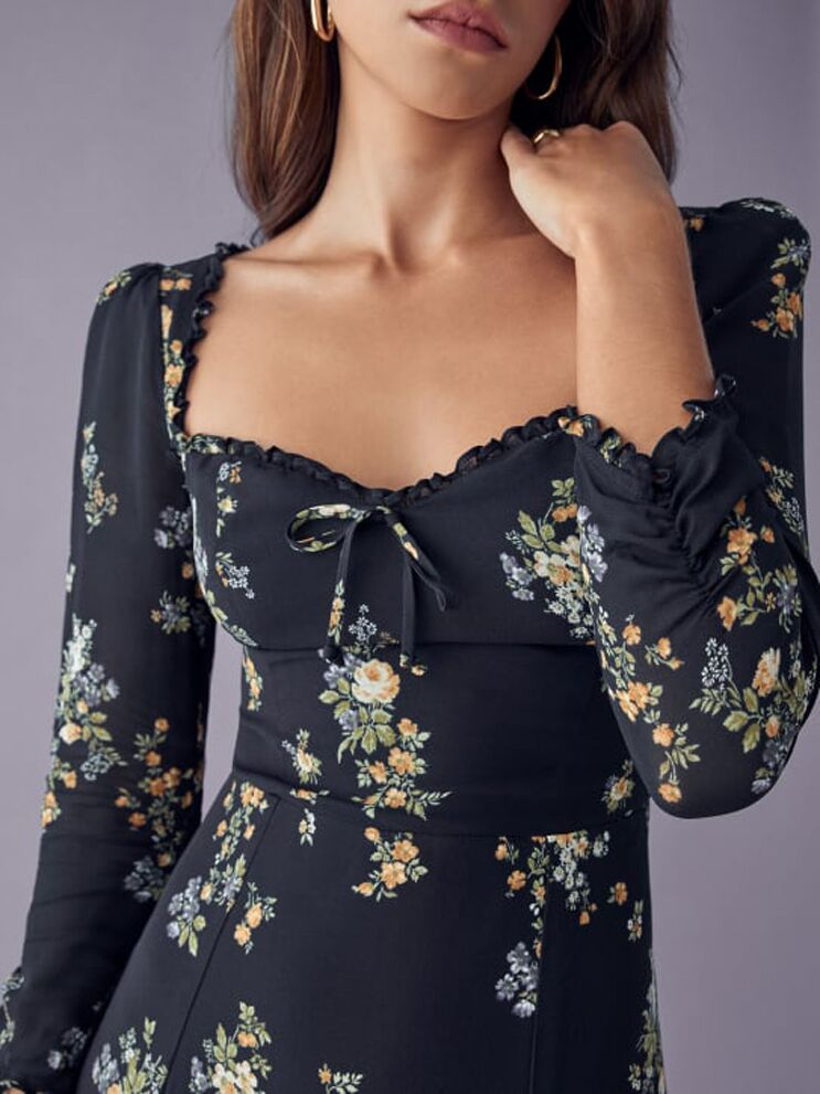 Black floral long sleeve dress with ruffles on neckline